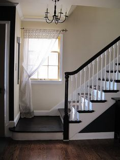 Stained staircase treads & rail - the rest of the staircase in high gloss white paint -  no runner. Like the window treatment