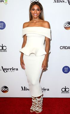 Ciara in a white off-the-shoulder white peplum dress