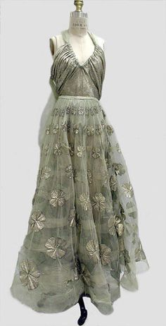 Madeleine Vionnet evening dress from 1939 is made of a gorgeous silvery-green lamé and has a net skirt covered in four-leaf clovers. It's just breathtaking!