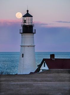 Full moon and Portland Head Lighthouse in Cape Elizabeth.