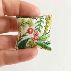 Dollhouse miniature pillow with flowers. Created by Miniarthouse.