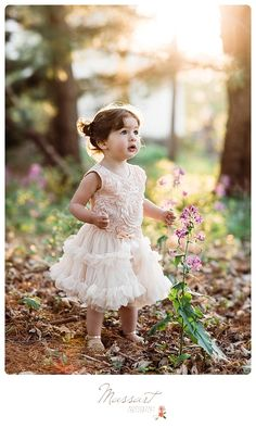 Outdoor spring picture of a little girl wearing a tutu playing in the woods | Photo by Massart Photography, RI MA CT | www.massartphotography.com; info@massartphotography.com
