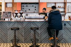 How WeWork Experiments On Itself to Advance the Field of Office Design,Gathering spaces at WeWork's headquarters offer a wide range of options in terms of informality and noise levels. The café tends to be fairly energetic. Image © Lauren Kallen