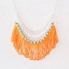 Amazing statement necklace using neon fringing, droplet beads and diamante. Sparkle and shine this autumn