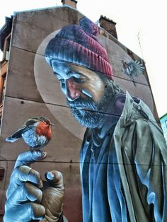 Smug One (aka Sam Bates) is an Australian born street artist based in Glasgow and as you walk the streets of the city it is hard to miss his enormous works of art that often adorn entire gable end walls.