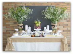 Wine and cheese party with baby's breath centerpieces and chalkboard decor
