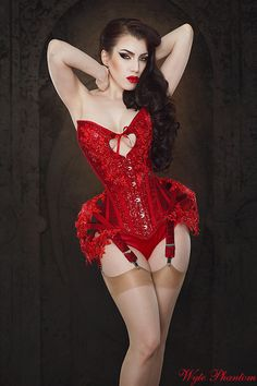 Threnody in Velvet/Iberian Black Arts for Wyte Phanton. Red corset with sweetheart neckline and heart cutaway with red garters and fawn stockings.