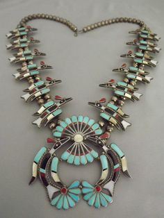 """Zuni  Peyote Water Bird Necklace. (Long necklaces like these are often called """"squash blossom"""" necklaces but they do not include the actual squash blossom."""