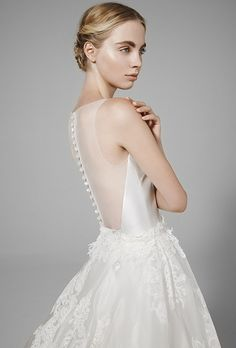 Brides: Peter Langner. Silk magnolia dress with detachable overskirt with flowers.