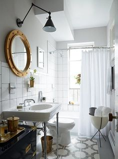 bathroom renovation inspiration - love that the mirror looks like a porthole!
