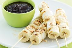 Snack idea: Toasted Coconut Banana and Marshmallow skewers dipped in rich creamy chocolate sauce.