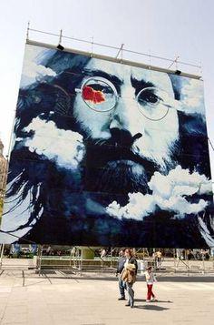 Cuban artist Waldo Saavedra displays his John Lennon mural in Guadalajara, Mexico