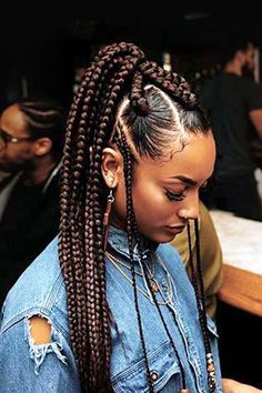 Instead of classic box braids, supermodel Jourdan Dunn edged up her style by incorporating different braid sizes. On the smaller front braids, she accessorized with beads.
