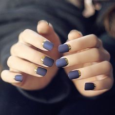 """Deep purple matte nail polish for the base and some metallic gold under. It's a perfect match to keep everything simple and yet elegant. The metallic gold gives the look a little """"kick"""" just to make it playful."""