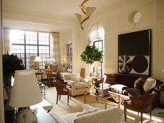 David Kleinberg:  The elegantly proportioned living room with its thirteen-and-a-half -foot ceilings.