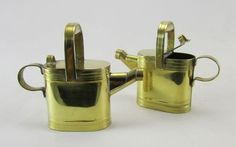 Brass hot water cans with hinged lids.