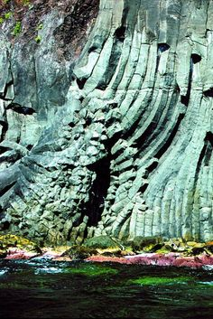 Basaltic columns which characterise the coast — at Acitrezza, Sicily