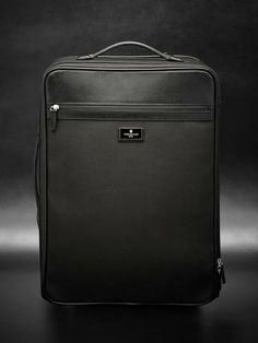 Leather and fabric carry-on with retractable mechanism and two sliding handles. Inside: two adjustable clothes strapsand one zipped pocket. Cm 40x50x20 #fw13 #men #accessories #luggage