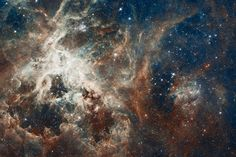 This photo from the Hubble Space Telescope shows the heart of the Tarantula nebula, a region teeming with star formation. The image is a giant mosaic view released on April 17, 2012 to mark Hubble's 22nd anniversary in space. ESO telescope observations augment the view.                                                 CREDIT: NASA/ESA/ESO