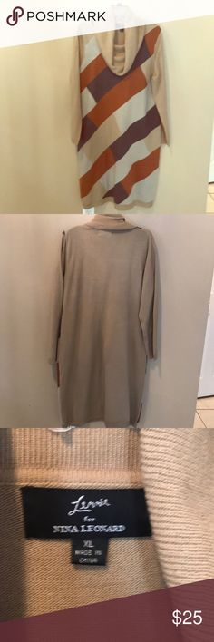 Sweater Dress!! The Bomb! Knitt 100% cotton Sweater Dress(XL)  16-18 size! Nice! Gray, Cognac and light khaki block design with solid back. I used to wear this dress with knee high cognac boots to set it off!! Very good condition. Worn a few times ! No wear and tear at all!! Love this Dress!! Unfortunately I loss weight so I can't rock it no more! And yes it clings to you. With right curves, it is Fitted and sexy! Nina Leonard Dresses Long Sleeve