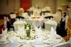 2013 Wedding Open Day at the London Marriott Hotel Regents Park.   Wedding Tip #7:  It may seem obvious, but make sure your chair covers match your table linen! Don't mix ivory chair covers with white table cloths – by Ross and Ben from Dossier Events ((www.dossierevents.com).