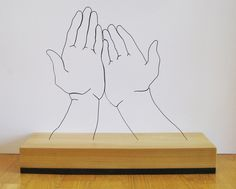 handssupplicated Gavin Worth wire sculpture