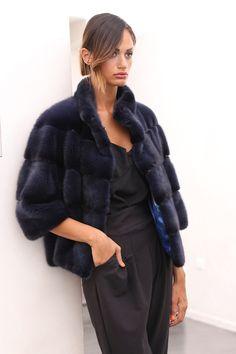Female Mink Fur Jacket with whole skins. Made in Italy. Skins Quality: Kopenhagen Fur Platinum; Color: Dark Blue; Closure: Wiht hooks; Collar: Round; Lining: 100% Satin; Lining Color: Fantasy, Multicolor; Length: 55 cm;
