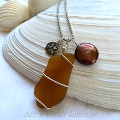 Authentic Sea Glass Charm Necklace, Silver Wire Wrapped Brown Sea Glass, Coin Pearl,  Sterling Silver Dollar Charm on Sterling Box Chain by denssilverlinings on Etsy https://www.etsy.com/listing/247385317/authentic-sea-glass-charm-necklace