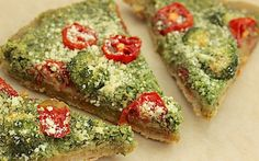 Instead of tomato sauce, this pizza is topped with a garlicky kale pesto, as well as vegan Parmesan, grape tomatoes, and broccoli.