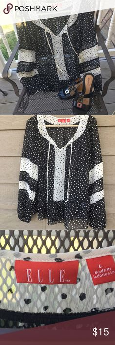 Elle Black and white polka dot Top A sheer long sleeve top! Wear a cami under and it's the perfect end of summer top! 🎉 Elle Tops Blouses