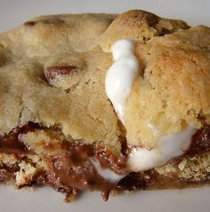 Recipe for Smores Stuffed Chocolate Chip Cookies - Have you ever seen a more delicious-looking cookie?! Me neither. And I've seen lots of cookies.