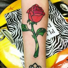 Enchanted rose tattoo