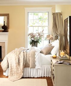 I like the neutrals in this, and the striped bedding, as well as the clean white of the sheets and dust ruffle
