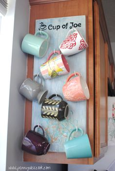 DIY Mug Holder. Hum.. I need something like this, I love mugs but don't have enough cabinet space for them all!