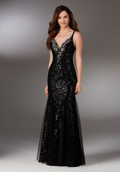 Evening Gowns and Mother of the Bride Dresses by Morilee. Allover Beaded Net Evening Gown Featuring a Deep V Neckline Accented with Contrasing Beadwork.