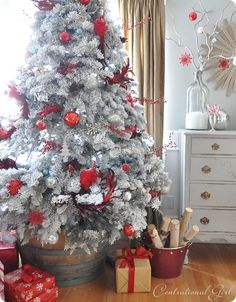 I love the idea of putting your Christmas tree in a big barrel! So pretty, and you don't need a tree skirt!
