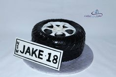 TYRE AND NUMBER PLATE CAKE  We have done a few of these tyre cakes and they are fantastic for a young man turning 18. This butter cake is accompanied with its very own number plate.  www.cakesbythelake.com.au