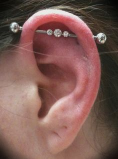 Industrial barbell with BVLA white gold insert