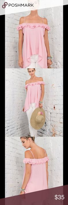SALELOVELY PINK HI LO RUFFLE HEM TOP Pretty & feminine Pink Top with Hi Lo ruffled hem, & crepe like texture. It features both adjustable spaghetti straps & off the shoulder Bardot look. Very romantic look. Sizes S, M, L. Rayon. No trades. Price is firm. New, but vendor does not include tag. Tops Blouses