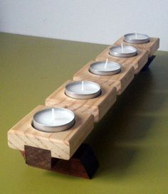 Portavelas para cinco velas de diametro 4cmRealizado en madera de pino y ipeSe puede realizar en otras maderas y dimensiones ( el coste puede variar)
