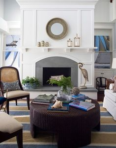 Contemporary living room with fireplace and moldings