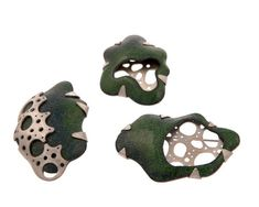 Jessica Lucas,   hydraulic pressed copper, enamel and saw pierced sterling silver brooches based on drawings of plant cross sections.
