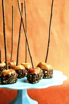 Mini Caramel Apples Coated in Chocolate and Nuts -- would pretty up any Thanksgiving gathering.