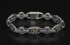 Sterling silver bracelet, inlaid with a piece of 10,000 year old fossil Woolly Mammoth tooth, and citrine.