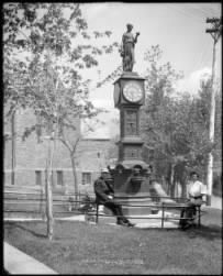 The Wheeler clock was given to the town of Manitou Springs in 1890 by mineral water bottling magnate, Jerome Wheeler to commemorate the opening of the Manitou Mineral Water Bottling Company. Made of cast iron, the top of the clock is adorned with a statue of the Greek goddess Hebe. She is the goddess of youth, and is daughter of Zeus and Hera. Her special tasks are pouring the nectar of the gods, preparing Ares' bath, and helping Hera to her chariot.