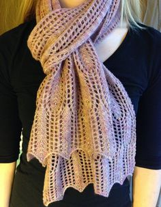 Free Knitting Pattern for Waves of Grain Scarf - Generously sized scarf with lace ends resembling heads of wheat connected by a middle section with a two-row repeat that can be memorized very quickly. Designed by Rosemary Hill. Pictured project by Erin