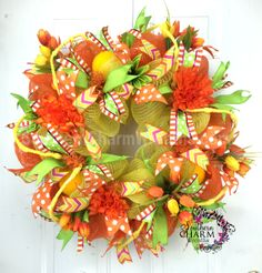 Deco Mesh Spring Wreath - Yellow -Orange - Spring Decor -Tulip Wreath by www.southerncharmwreaths.com #spring #wreath #mesh