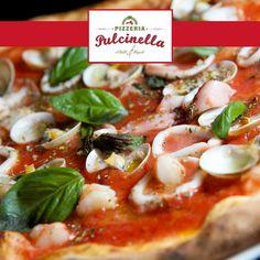 Frutti di Mare pizza - For all seafood lovers this is a tomato based sauce with fresh calamari, prawns, clams, garlic and oregano... pulcinelladubai.com   800 PIZZERIA. #Prawns #delicious #pizza #gnamgnam