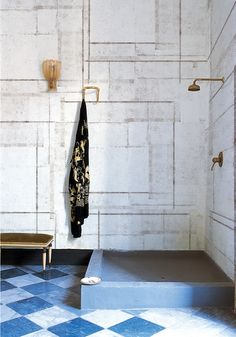 gold fixtures with beautiful blue and white tile.