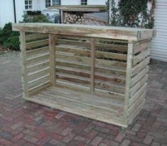 """Called a """"log store"""" (firewood storage) but could be modified to be a small greenhouse."""